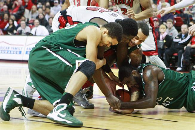 UNLV forward Anthony Bennett fights for a loose ball with Chicago State's Clarke Rosenberg, left, Jeremy Robinson and Quinton Pippen, right, during their game Thursday, Jan. 3, 2013 at the Thomas & Mack Center. UNLV won the game 74-52.