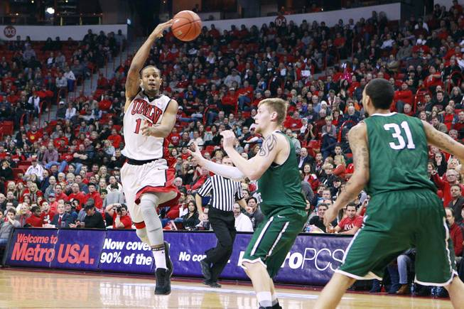 UNLV guard Bryce Dejean-Jones makes a no-look pass that would result in a turnover to Chicago State during their game Thursday, Jan. 3, 2013 at the Thomas & Mack Center. UNLV won the game 74-52.