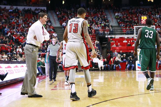 After turing the ball over on a no-look pass, UNLV guard Bryce Dejean-Jones gets an earful from coach Dave Rice during their game against Chicago State Thursday, Jan. 3, 2013 at the Thomas & Mack Center. UNLV won the game 74-52.