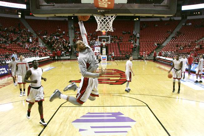 UNLV guard Anthony Marshall warms up with the rest of the Runnin' Rebels before their game against Chicago State Thursday, Jan. 3, 2013 at the Thomas & Mack Center.