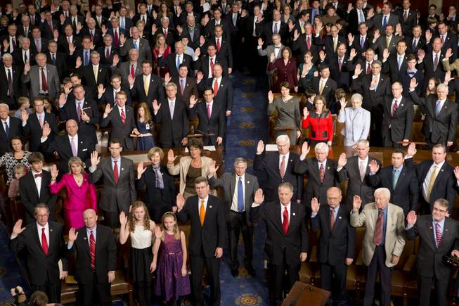 Members of the 113th Congress, many accompanied by family members, take the oath of office in the House of Representatives chamber on Capitol Hill in Washington, Thursday, Jan. 3, 2013.