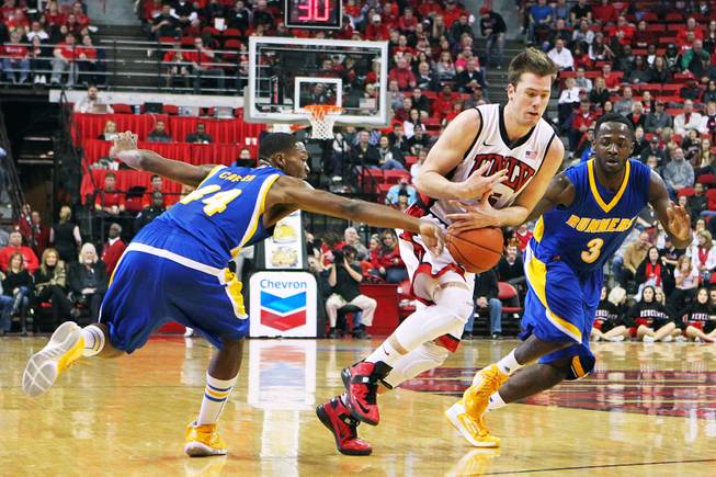 UNLV guard Katin Reinhardt loses the ball while being defended by Cal State Bakersfield guards Stephon Carter, left, and Javonte Maynor during their game Saturday, Jan. 5, 2013, at the Thomas & Mack Center. UNLV won their non-conference finale 84-63.