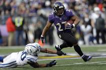 Baltimore Ravens running back Ray Rice gets away from Indianapolis Colts linebacker Jerrell Freeman for a 47-yard gain during the first half of an NFL ...