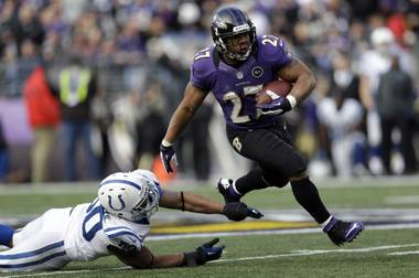 Baltimore Ravens running back Ray Rice gets away from Indianapolis Colts linebacker Jerrell Freeman for a 47-yard gain during the first half of an NFL wildcard playoff game Sunday, Jan. 6, 2013, in Baltimore.