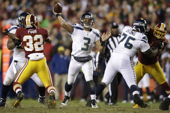 Seattle Seahawks quarterback Russell Wilson throws a pass during the second half of an NFL wild card playoff football game against the Washington Redskins in Landover, Md., Sunday, Jan. 6, 2013.