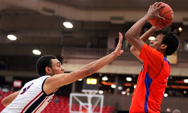 Nigel Williams-Goss, left, of Findlay Prep reaches to block a shot by Rashad Muhammad of Bishop Gorman during their boys basketball game at the South Point Arena in Las Vegas on Monday, January 7, 2013.