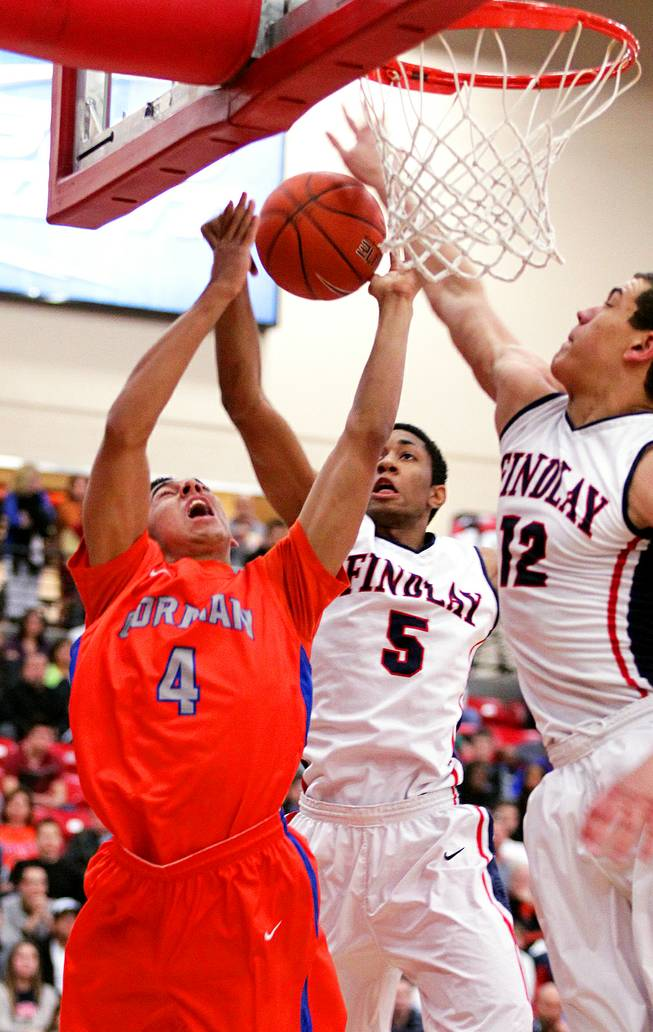 Trey Kennedy, from left, of Bishop Gorman battles with Christian Wood and Gavin Schilling of Findlay Prep during their boys basketball game at the South Point Arena in Las Vegas on Monday, January 7, 2013.