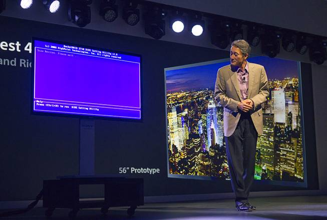 Kazuo Hirai, president and CEO of Sony Corporation, looks at a prototype OLED television after the TV lost the video signal during a Sony news conference at the 2013 International CES in the Las Vegas Convention Center Monday, January 7, 2013.