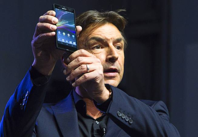 Phil Molyneux, president and COO of Sony Electronics Inc., displays a Sony Xperia Z smart phone during a Sony news conference at the 2013 International CES in the Las Vegas Convention Center Monday, January 7, 2013.