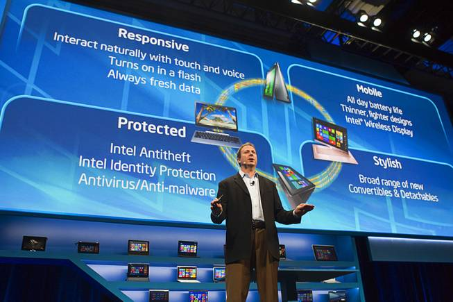 "Kirk Skaugen, vice president of PC client group for Intel, speaks at an Intel press conference during the 2013 International CES in the Mandalay Bay Convention Center Monday, January 7, 2013. Intel announced improvements to its processors including one with ""all day"" battery life. Intel also announced the availability of live and on-demand pay TV content to Intel devices."