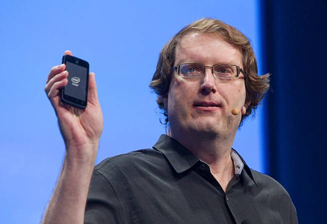 "Mike Bell, vice president on Intel's mobile and communications group, holds a smart phone powered by an Intel processor at an Intel press conference during the 2013 International CES in the Mandalay Bay Convention Center Monday, January 7, 2013. Intel announced improvements to its processors including one with ""all day"" battery life. Intel also announced the availability of live and on-demand pay TV content to Intel devices."