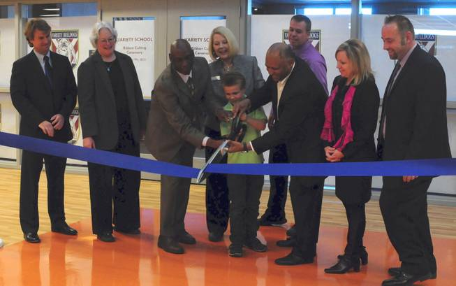 Clark County School District officials, developers and a student cut a ribbon to open Variety School's new campus, 2800 East Stewart Ave., on Monday, Jan. 7, 2013. The replacement school features kitchen facilities, a mock apartment and laundry facilities to teach life and vocational skills to special-needs students.