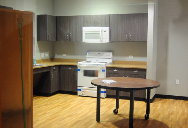 A mock apartment is shown through the classroom door window at Variety's new campus, 2800 East Stewart Ave., on Monday, Jan. 7, 2013. The replacement school features kitchen facilities, a mock apartment and laundry facilities to teach life and vocational skills to special-needs students.
