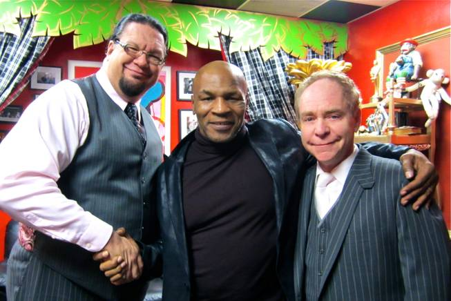 Mike Tyson is flanked by Penn & Teller at The Rio.
