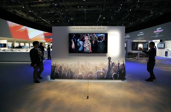 Technicians install Sony's 4k Ultra HD television at the Sony booth at the International Consumer Electronics Show in Las Vegas, Monday, Jan. 7, 2013.