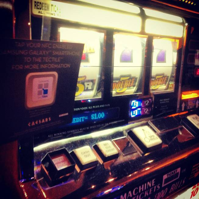 A Samsung TecTile is shown on a slot machine at Caesars Palace, Monday, Jan. 7, 2012.