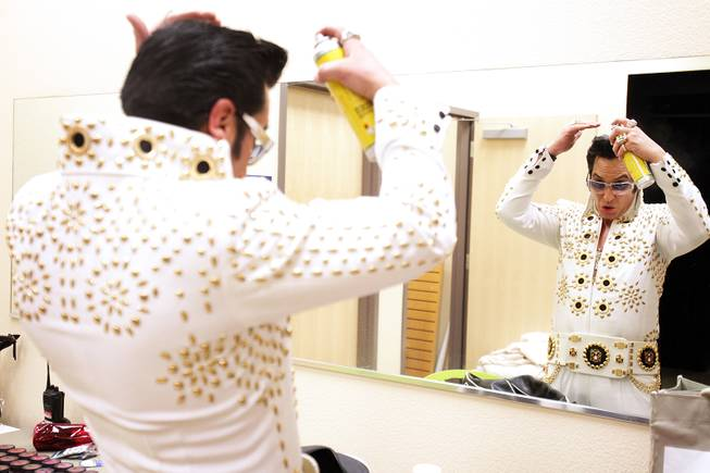 Elvis impersonator Jesse Garon gets ready backstage before a celebration of Elvis Presley's birthday at Opportunity Village Engelstad Campus on Tuesday, Jan. 8, 2013, in Las Vegas.