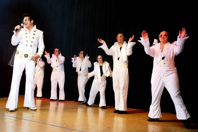 Elvis impersonator Jesse Garon performs with the OV Elvi dance troupe during a celebration of Elvis Presley's birthday at Opportunity Village Engelstad Campus in Las Vegas on Tuesday, January 8, 2013.