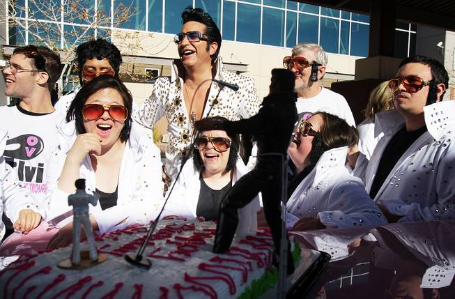 Elvis impersonator Jesse Garon, center, and members of the OV Elvi dance troupe and Roaring Thunder percussion team sing Happy Birthday with a cake during a celebration of Elvis Presley's birthday at Opportunity Village Engelstad Campus in Las Vegas on Tuesday, January 8, 2013.