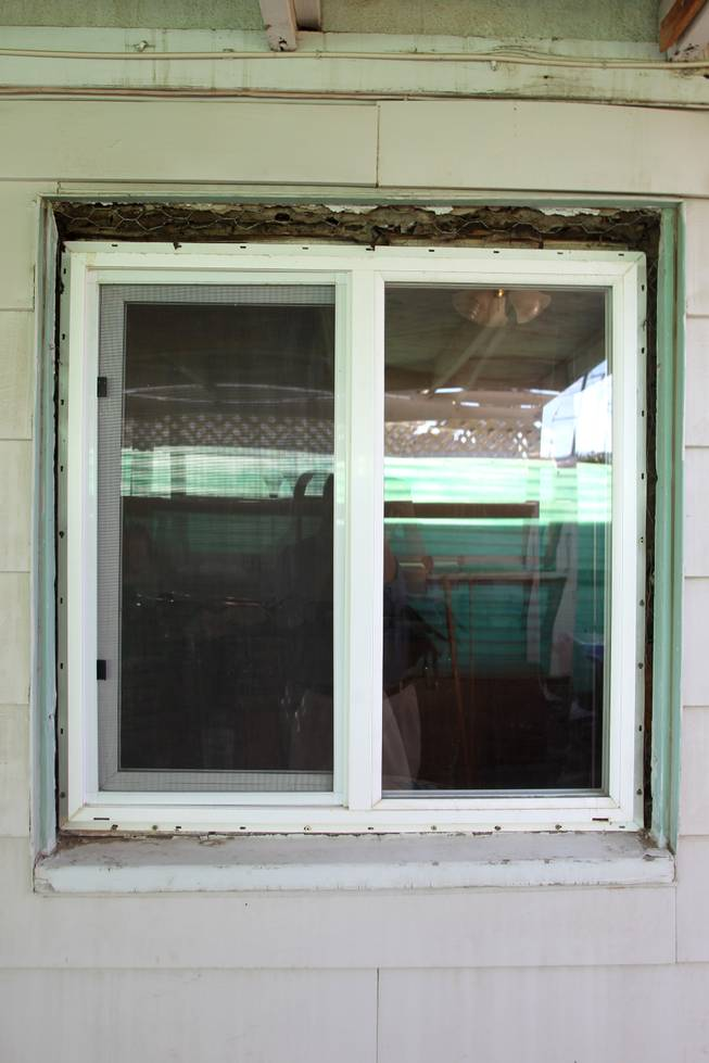 Tobie Ortiz's Henderson house Tuesday, Jan. 8, 2013 that she bought out of foreclosure has a number of replacement windows lacking trim.