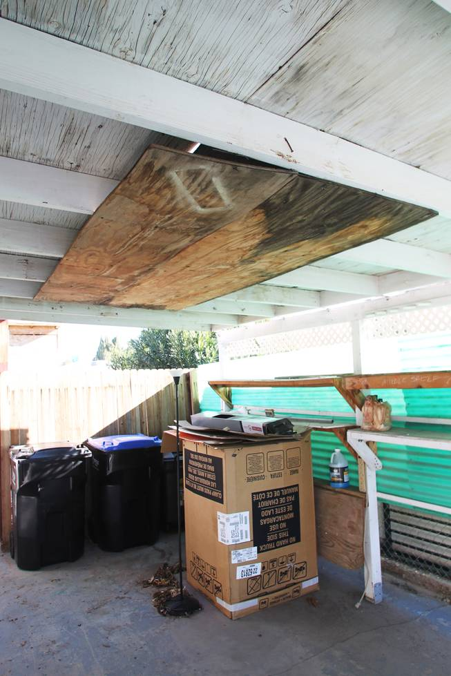The carport, with the previous owner's solution to a leaky roof, at Tobie Ortiz's Henderson house Tuesday, Jan. 8, 2013 which she bought out of foreclosure.