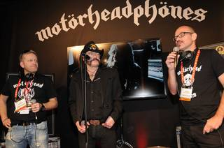 Motorhead's Lemmy Kilmister unveils Motorheadphones at CES on Tuesday, Jan. 8, 2013. Flanking him are headphone manufacturer Krusell International AB's Ulf Sandberg and Anders Nicklasson.