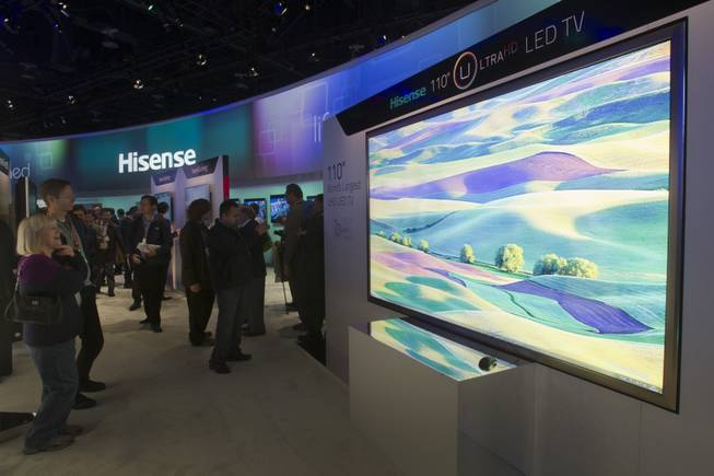 A Hisense 110-inch Ultra HD LED television, the world's largest, is displayed during the first day of the 2013 International CES in the Las Vegas Convention Center Tuesday, Jan. 8, 2013. STEVE MARCUS