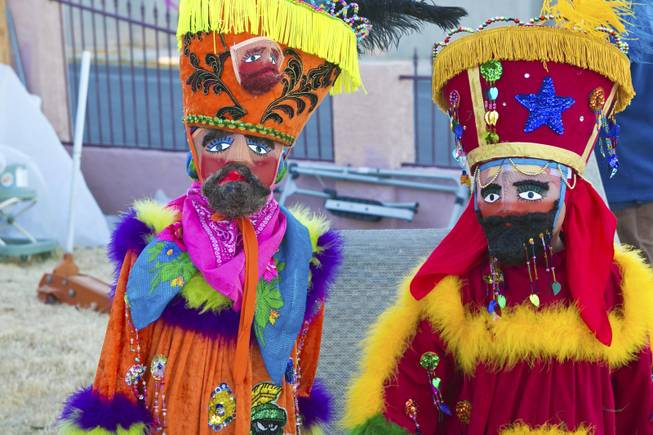 "Two child Chinelos, dancers, from a local cultural dance troupe ""Comparza Morelense"" are costumed in traditional Morelos, Mexico dance costumes, Tuesday, Jan. 8, 2013. The troupe has been invited to perform at President Obama's inauguration parade on January 21."