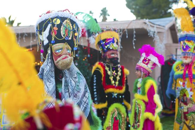 A look at the colorful costumes of the Comparza Morelense cultural dance troupe, Tuesday, Jan. 8, 2013. The troupe has been invited to perform at President Obama's inauguration parade on January 21.
