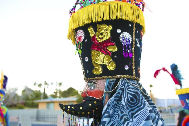 "A sequenced Winnie the Pooh decorates the side of this traditional Morelos, Mexico Chinelo, dancer, mask, Tuesday, Jan. 8, 2013. The ""Comparza Morelense,"" a local Las Vegas cultural dance troupe, has been invited to perform at President Obama's inauguration parade on January 21."