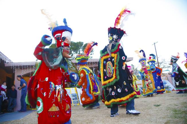 "Chinelos, dancers, perform their ""Brinco del Chinelo"" dance, Tuesday, Jan. 8, 2013. The ""Comparza Morelense,"" a local Las Vegas cultural dance troupe, has been invited to perform at President Obama's inauguration parade on January 21."