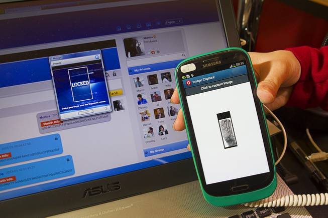 A PrivacQ cell case with built-in finger print scanner is displayed during the 2013 International CES Wednesday, January 9, 2013. The Hong Kong-based company, a subsidiary of World Wide Touch Technology, also showed FingerQ, a web-based platform that provides secure social networking capability.