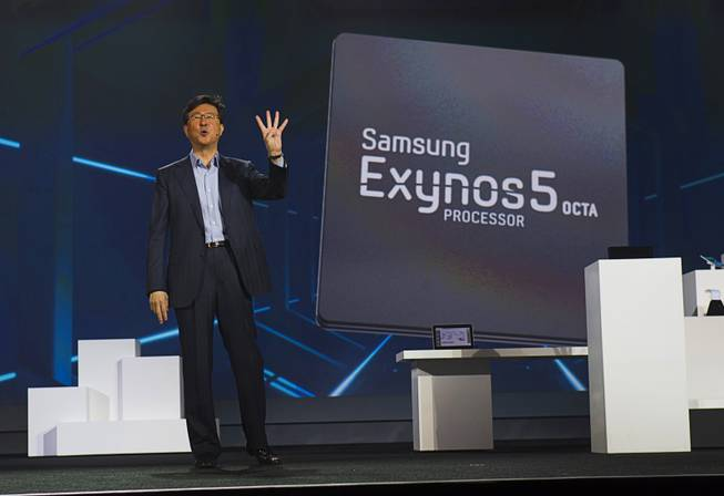 Stephen Woo, president of Device Solutions Business for Samsung Electronics, talks about the new Samsung Exynos 5 Octa processor during a keynote address at the 2013 International CES Wednesday January 9, 2013. The processor is faster and uses less power than Samsung's previous models, he said.