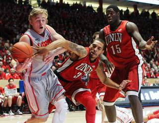 UNLV guard Anthony Marshall knocks the ball out of the hands of New Mexico guard Hugh Greenwood during their game Wednesday, Jan. 9, 2013, at The Pit in Albuquerque.