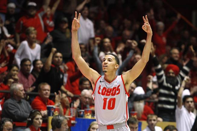 New Mexico guard Kendall Williams celebrates after dropping one of his two three-point shots late in the game to put them ahead of UNLV for good Wednesday, Jan. 9, 2013 at The Pit in Albuquerque. New Mexico won the game 65-60.