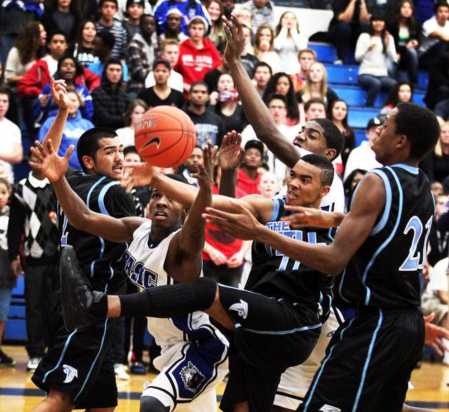 Players fight for a rebound during a boys basketball game between Basic and Foothill at Basic High School in Henderson on Wednesday, January 9, 2013.