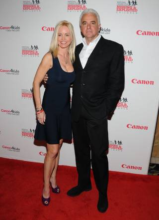 Lisa Mesioh and John O'Hurley arrive at the red carpet for the 2013 Canon USA and National Center for Missing and Exploited Children benefit at the Bellagio on Wednesday, Jan. 9, 2013.