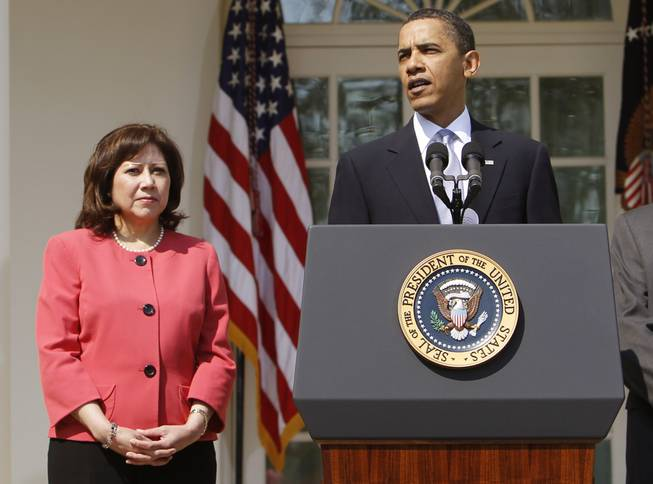This April 15, 2010, file photo shows Labor Secretary Hilda Solis standing with President Barack Obama in the Rose Garden of the White House in Washington. Solis is telling colleagues she is leaving the Obama administration.