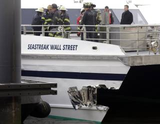 New York City firefighters walk the deck of the Seastreak Wall Street ferry in New York,  Wednesday, Jan. 9, 2013.