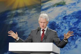 Former President Bill Clinton speaks during Samsung's keynote address at the International Consumer Electronics Show in Las Vegas, Wednesday, Jan. 9, 2013.