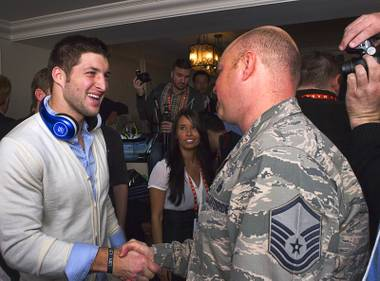 NFL quarterback Tim Tebow meets with reporters and guests following a news conference to promote the Tim Tebow Signature Series headphones by Soul Electronics at the 2013 International CES Thursday, Jan. 10, 2013.