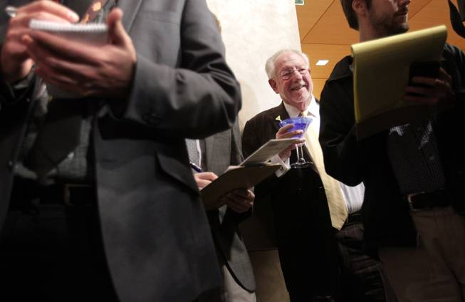 Oscar Goodman watches as his wife, Mayor Carolyn Goodman, talks to the press after delivering the State of the City address at Las Vegas City Hall on Thursday, January 10, 2013.