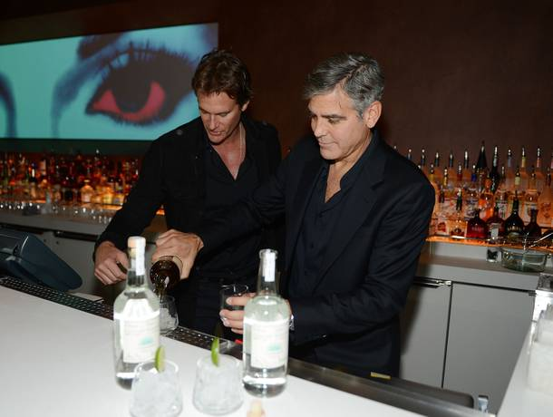 Casamigos Tequila founders Rande Gerber and George Clooney celebrate the launch of their tequila at Andrea's in the Encore on Wednesday, Jan. 9, 2013.