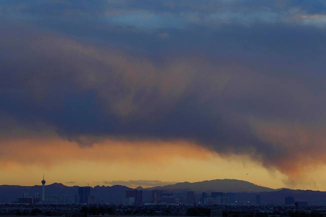 Clouds hang over the Las Vegas Valley as the sun sets behind the Spring Mountains Friday, Jan. 11, 2013.