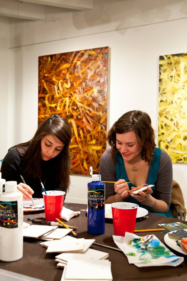 Alexandra Gutierrez, 23, and Shanna Rosing, 22, work on painted squares.