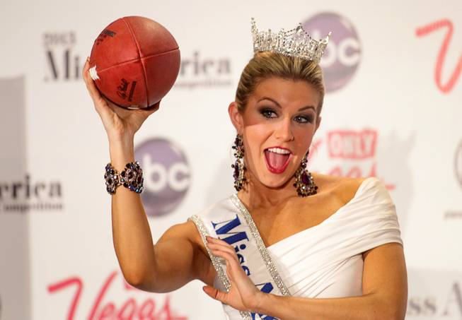 2013 Miss America Mallory Hytes Hagan, 23, of New York poses with a football during a news conference after winning the 2013 Miss America Pageant in PH Live at Planet Hollywood on Saturday, Jan. 12, 2013.
