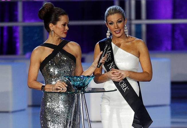 Miss New York Mallory Hytes Hagan, right, answers a question about gun control with co-host Brooke Burke-Charvet during the 2013 Miss America Pageant in PH Live at Planet Hollywood on Saturday, Jan. 12, 2013. Hagan was later named 2013 Miss America.