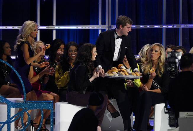 Doughnuts are served to contestants who didn't make it to the semifinals during the 2013 Miss America Pageant in PH Live at Planet Hollywood on Saturday, Jan. 12, 2013.