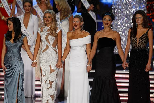 Miss New York Mallory Hytes Hagan, center, waits onstage with other finalists during the 2013 Miss America Pageant in PH Live at Planet Hollywood on Saturday, Jan. 12, 2013. From left are Miss Oklahoma Alicia Clifton, Miss South Carolina Ali Rogers, Hagan, Miss Iowa Mariah Cary and Miss Wyoming Lexie Madden. Hagan was later named 2013 Miss America.