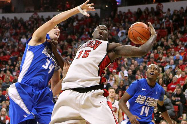 UNLV forward Anthony Bennett loses the ball after being fouled by Force center Taylor Broekhuls during their game Saturday, Jan. 12, 2013 at the Thomas & Mack. UNLV won in overtime, 76-71.